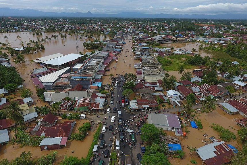 The extent of flooding in Bengkulu, Sumatra, last Saturday. About 12,000 people have been evacuated while hundreds of buildings, bridges and roads have been damaged by the severe weather, which affected nine districts or towns across Bengkulu provinc