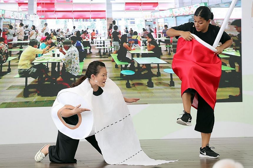"A skit being put up at the launch of the Public Hygiene Council's ""Keep Clean, Singapore"" campaign yesterday at Bedok Town Square."