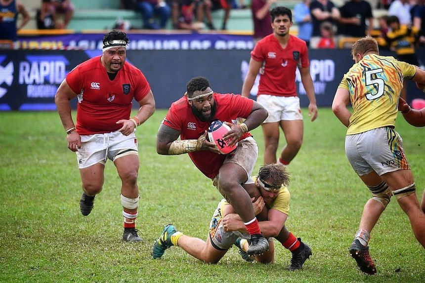 Asia Pacific Dragons' prop Ropate Rinakama getting tackled in yesterday's Global Rapid Rugby match against the South China Tigers at the Queenstown Stadium. The Dragons won 41-26.