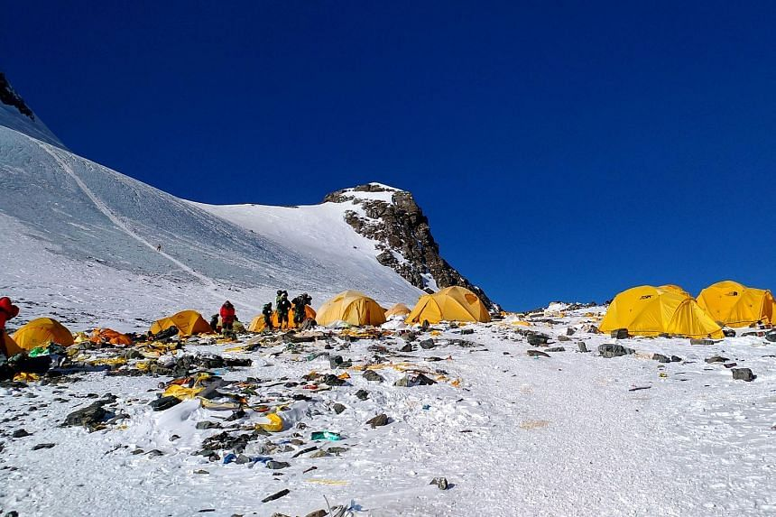 Discarded climbing equipment and rubbish scattered around Camp 4 of Mount Everest. Hundreds of climbers, sherpas and high-altitude porters make their way to Everest annually and leave behind tonnes of waste.