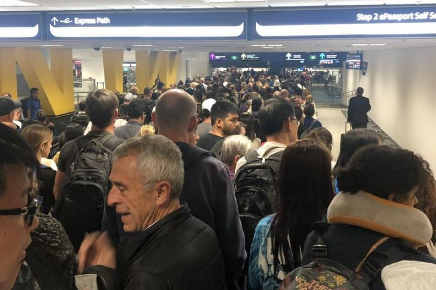 Social media users reported and shared images of long queues at airports across Australia.