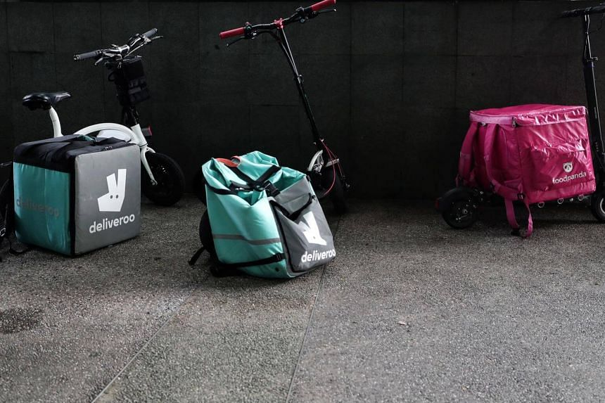 Scooters used for food delivery firms parked at Clementi MRT station.