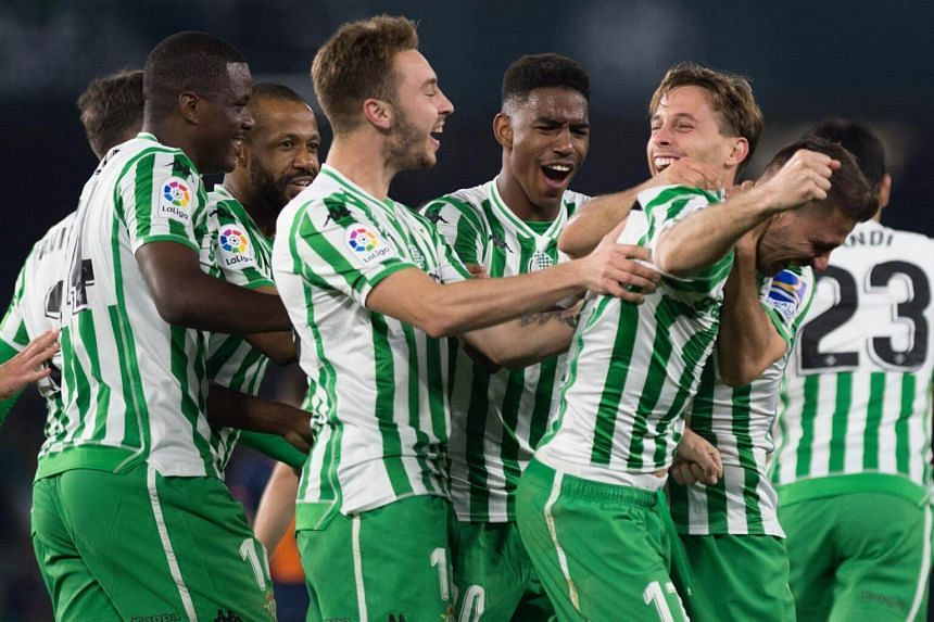 Real Betis' players celebrate after scoring their second goal during the Spanish Copa del Rey semi-final first leg football match against Valencia CF at the Benito Villamarin stadium, on Feb 7, 2019.