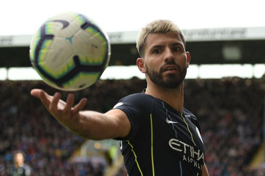 Manchester City's Argentinian striker Sergio Aguero retrieves the ball during the EPL football match between Burnley and Manchester City at Turf Moor in Burnley, north west England on April 28, 2019.