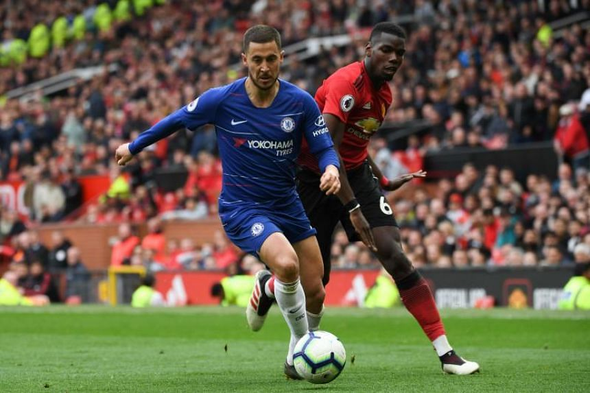 Chelsea's Belgian midfielder Eden Hazard (left) beats Manchester United's French midfielder Paul Pogba during the EPL football match between Manchester United and Chelsea at Old Trafford in Manchester, north west England, on April 28, 2019.