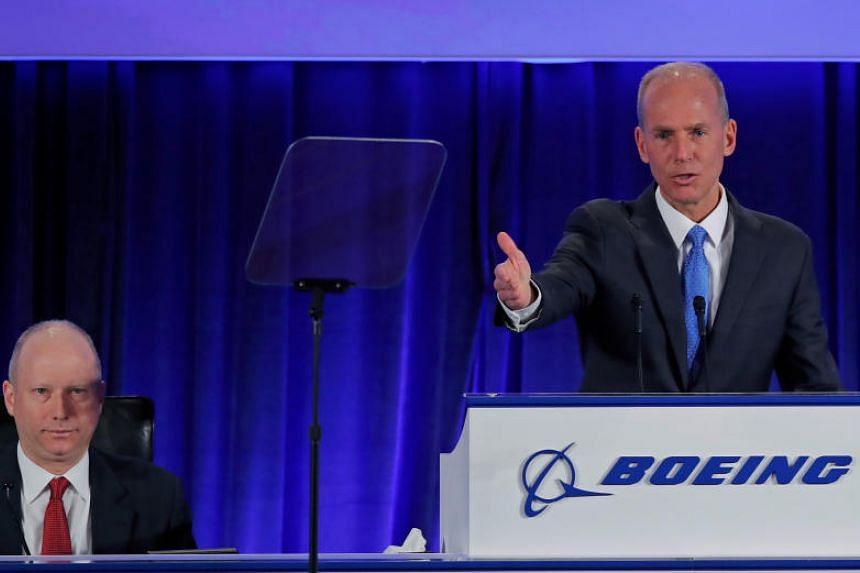 Boeing Co chief executive Dennis Muilenburg speaks, as Boeing vice-president and corporate secretary Grant Dixton (left) looks on, during the general annual shareholder meeting at the Field Museum in Chicago, Illinois, US, on April 29, 2019.