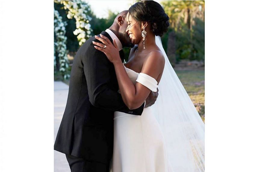 Idris Elba sharing an embrace with his wife Sabrina Dhowre.