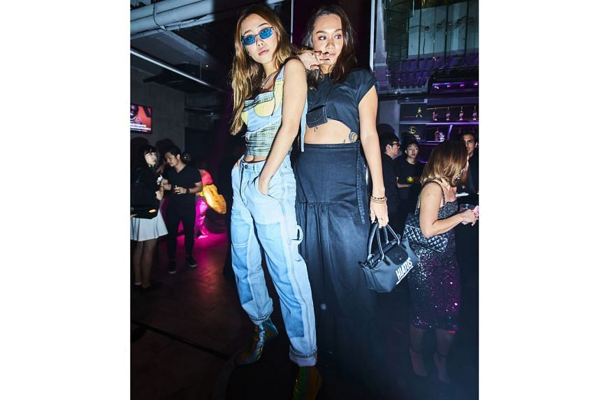 Surrender's creative manager Mae Tan (left) and public relations manager Guan Min (right) at the three-storey shophouse which was transformed into a 1970s-style nightclub.