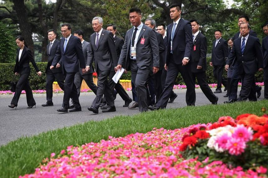 Prime Minister Lee Hsien Loong and Chinese Premier Li Keqiang making their way to a lunch reception at Diaoyutai State Guesthouse in Beijing on April 29, 2019.