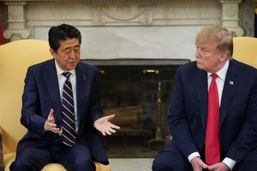 Japan's Prime Minister Shinzo Abe (left) in a bilateral meeting with US President Donald Trump in the Oval Office of the White House in Washington, DC on April 26, 2019.