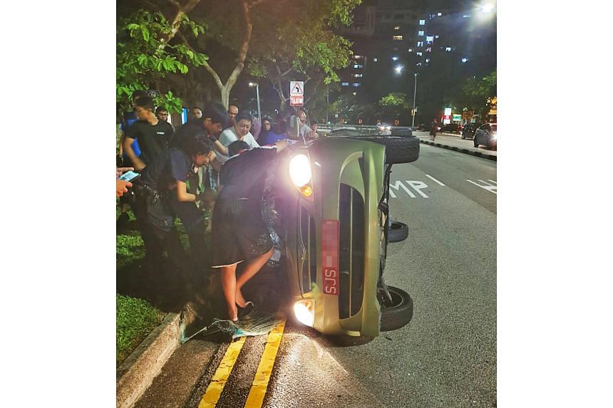 An eyewitness said some passers-by helped flip the car, which had overturned, onto its side.