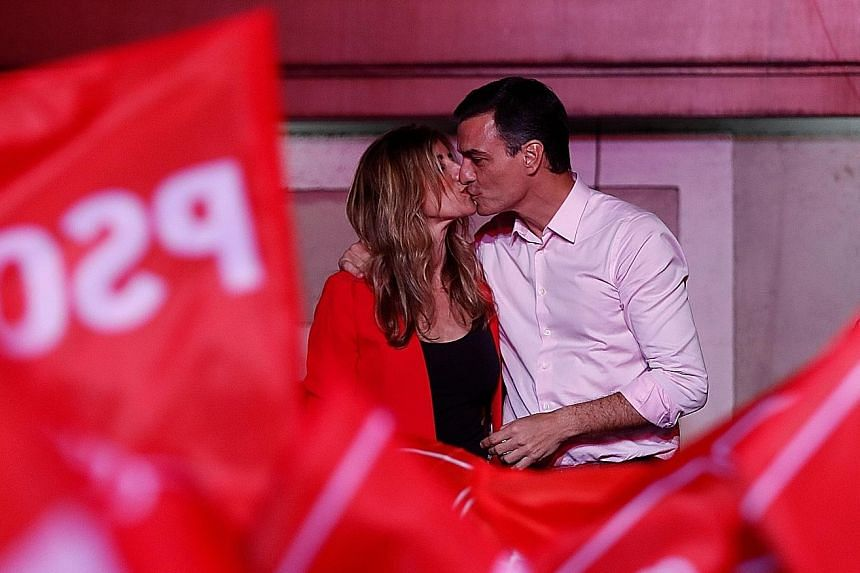 Spain's Prime Minister Pedro Sanchez of the Socialist Workers' Party celebrating with his wife Begona Gomez after winning the general election with the most number of seats in Madrid yesterday.