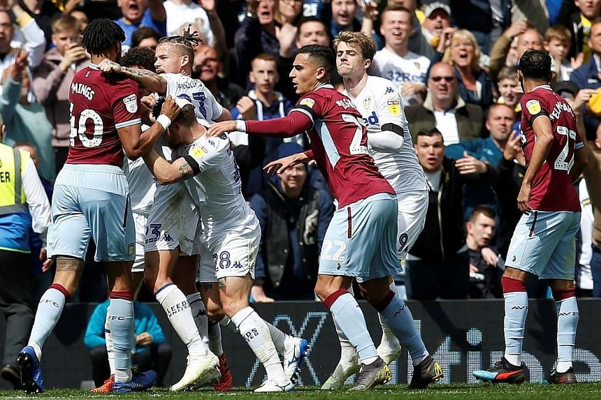 A controversial goal by Leeds' Mateusz Klich, scored while Aston Villa striker Jonathan Kodjia was injured, sparked a series of on-field melees among players from both teams at Elland Road on Sunday. PHOTO: REUTERS