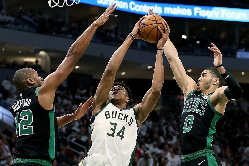 Giannis Antetokounmpo (centre) managed 22 points and eight rebounds but was powerless in the Milwaukee Bucks' surprise 112-90 home loss to the visiting Boston Celtics in Game 1 of the Eastern Conference semi-finals.