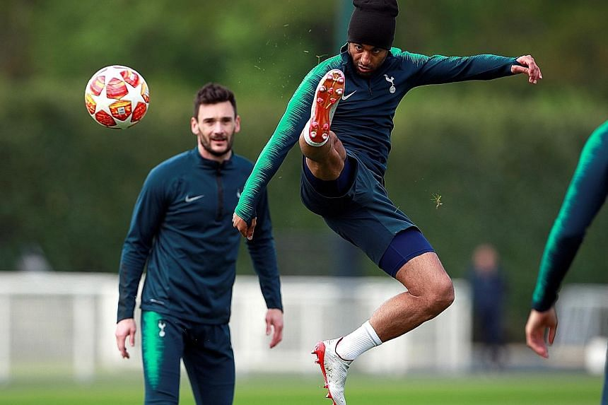 Tottenham's Lucas Moura training with goalkeeper Hugo Lloris as they prepare for the first leg of their Champions League semi-final against Ajax Amsterdam at the Tottenham Hotspur Stadium today. The Brazilian forward is expected to lead his team's at