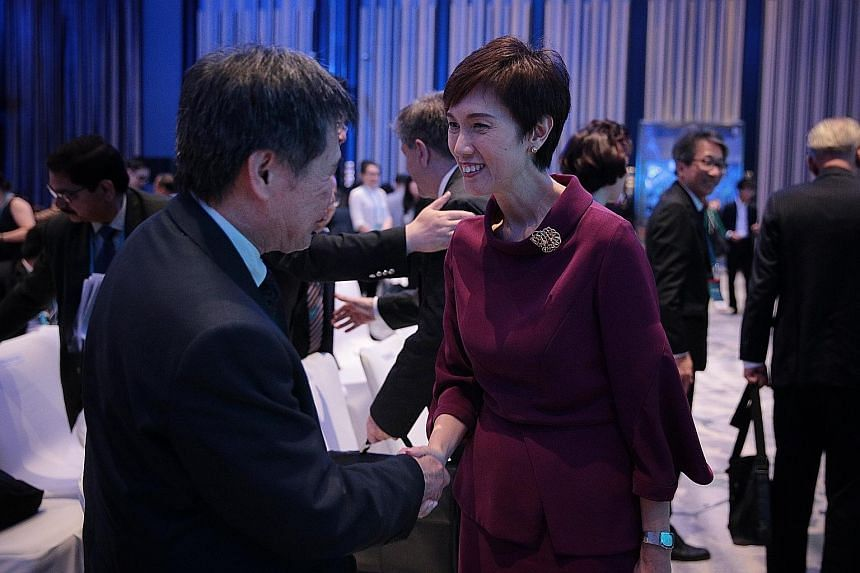 Manpower Minister Josephine Teo meeting Asean Secretary-General Lim Jock Hoi at the Singapore Conference on the Future of Work yesterday. About 700 international delegates are attending the conference, which ends today.