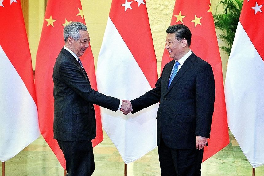 Prime Minister Lee Hsien Loong with Chinese President Xi Jinping at the Great Hall of the People in Beijing yesterday. PM Lee said Singapore has been preparing for a transition for a long time, getting younger ministers to actively engage China on va