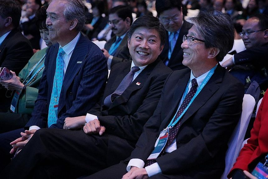 At the Singapore Conference on the Future of Work at Raffles City Convention Centre yesterday were (from left) Singapore National Employers Federation president Robert Yap, National Trades Union Congress secretary-general Ng Chee Meng and former manp