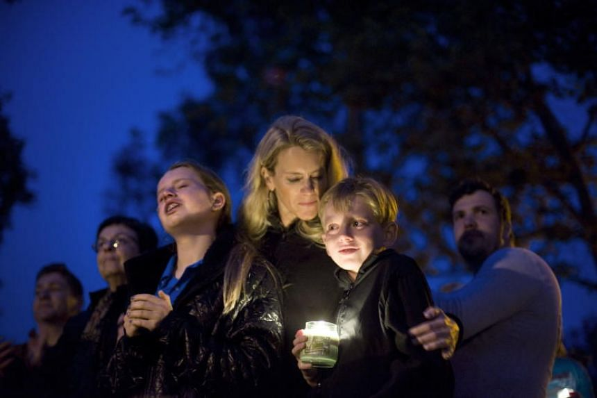 People participate in a vigil and prayer service in Poway, California, US, on April 28, 2019.