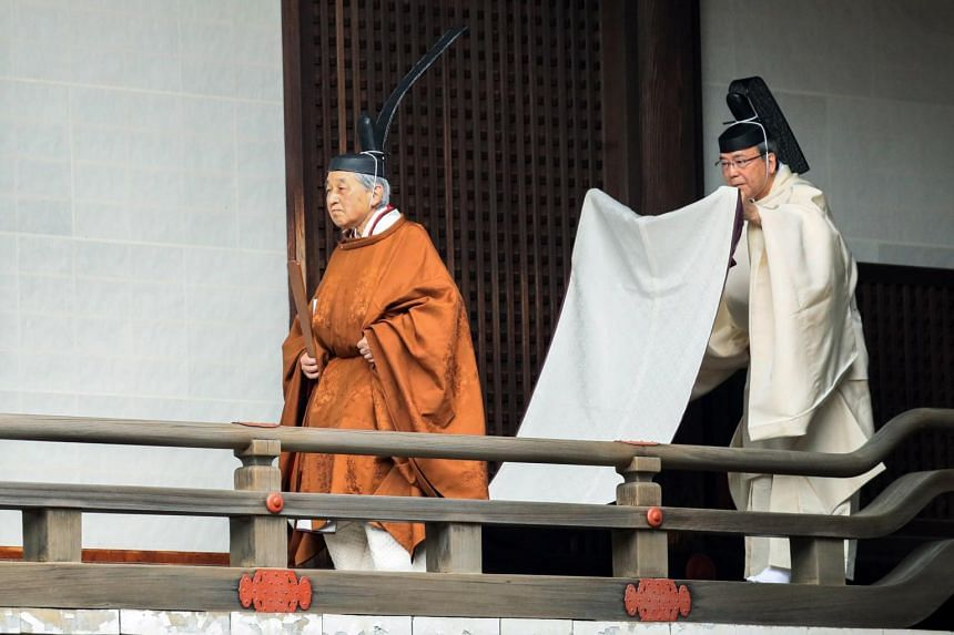 Japanese Emperor Akihito on his way to attend the Taiirei-Tojitsu-Kashikodokoro-Omae-no-gi, a rite of reporting at the Imperial Sanctuary on the day of the abdication ceremony, at the Imperial Palace in Tokyo on April 30, 2019.