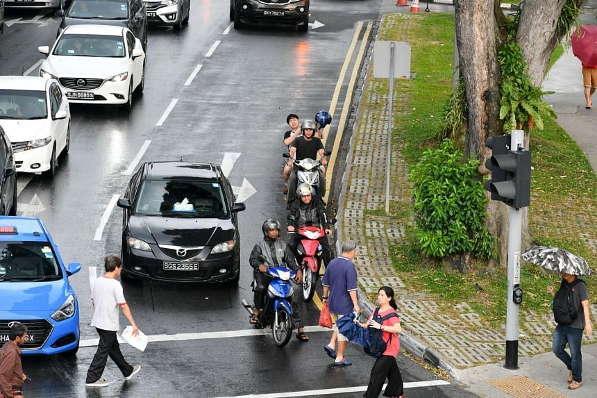 Vehicles stop at a traffic light along Admiralty Road towards Woodlands Town Centre, on Jan 10, 2017.