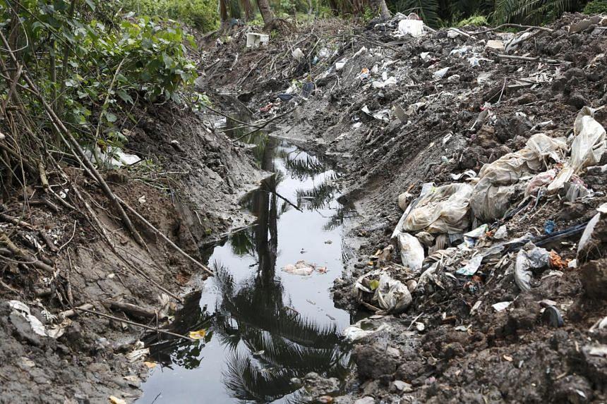 A polluted ditch at a dumpsite near a prawn farm at Jenjarom, Klang, outside Kuala Lumpur.