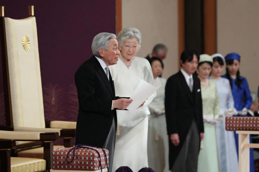 Japan's Emperor Akihito, flanked by Empress Michiko, delivers a speech at his abdication ceremony, at the Imperial Palace in Tokyo, Japan, on April 30, 2019.