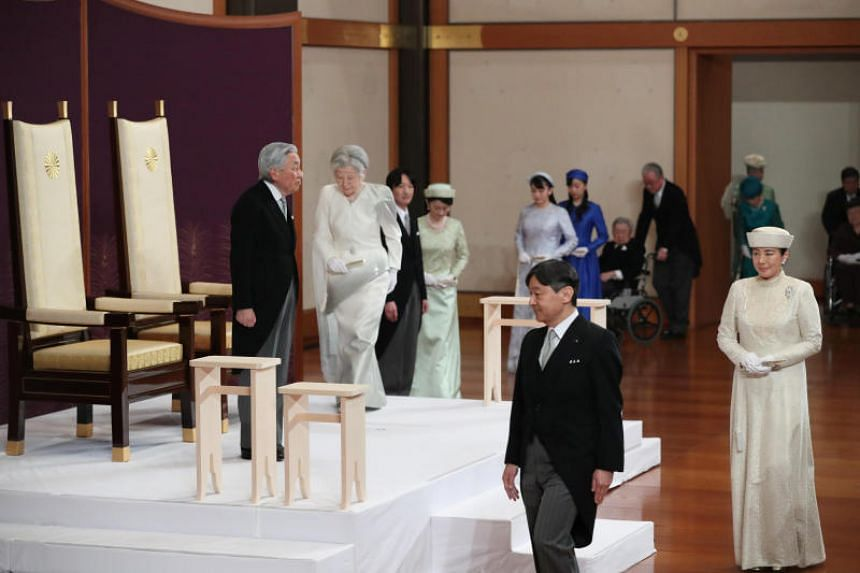 Japan's Emperor Akihito (top, left), Empress Michiko (top, right) and royal family members including Crown Prince Naruhito (bottom, left) and Crown Princess Masako (bottom, right) at the abdication ceremony at the Imperial Palace in Tokyo, on April 3