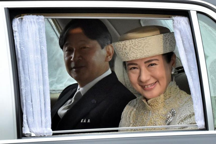 A vehicle carrying Japan's Crown Prince Naruhito and Crown Princess Masako arrives at the Imperial Palace in Tokyo on April 30, 2019.