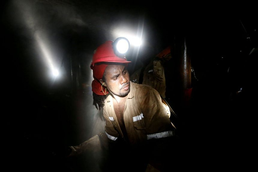 A miner works deep underground at a Sibanye Gold mine in Westonaria, South Africa, in 2017.