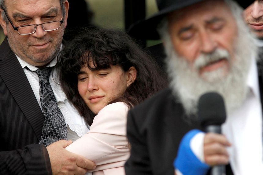 Howard Kaye holds his daughter Hannah Jacqueline Kaye at the funeral for Lori Gilbert-Kaye, the sole fatality of the shooting.