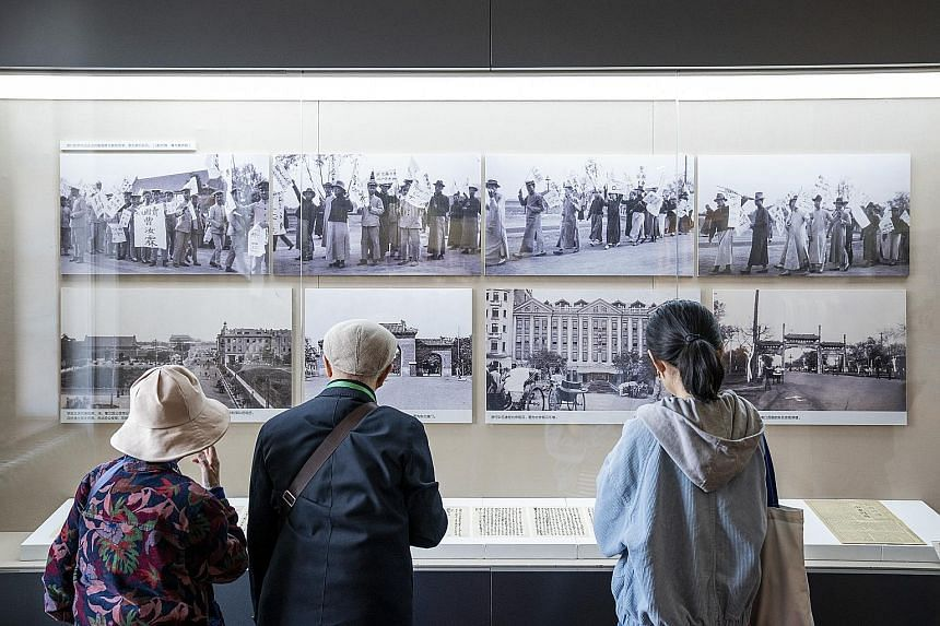 """Visitors at an exhibition, """"A Panorama of the May Fourth Movement"""", in the New Culture Movement Memorial Museum in Beijing last Friday."""