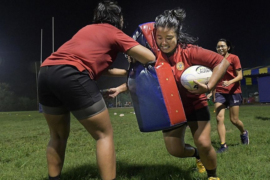 Ms Azurah Khalid at a rugby training session at Turf City last week. She has represented Singapore often in international women's rugby competitions, after recovering from a broken leg suffered during her first rugby game.