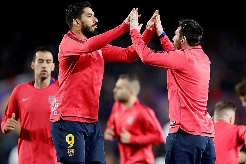 Barcelona's Luis Suarez (No. 9) and Lionel Messi will lead the Spanish champions' attack when they host Liverpool at the Nou Camp today.