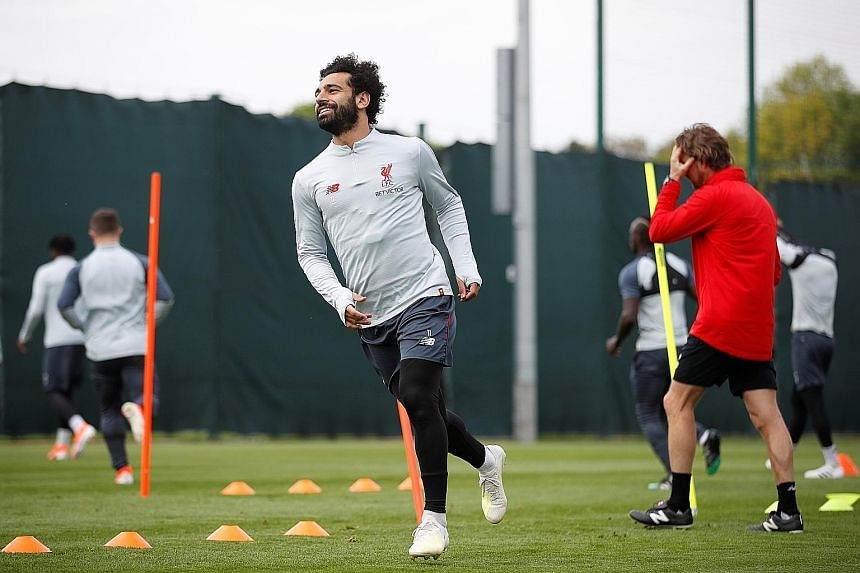 Liverpool's Mohamed Salah can count on his defensive teammates Trent Alexander-Arnold and Andrew Robertson to bomb forward against Barcelona in hope of chipping in with assists and goals.