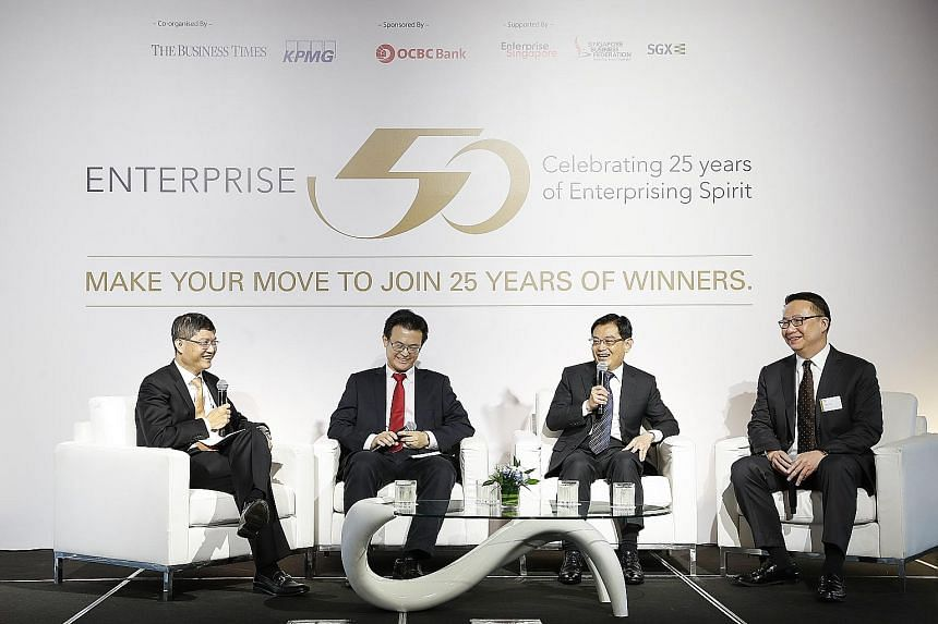 Finance Minister Heng Swee Keat (third from left) speaking at the launch of this year's Enterprise 50 Awards yesterday with (from left) Mr Ong Pang Thye, managing partner of KPMG Singapore; Mr Raymond Lim, associate director of Elmich; and Mr Toby Ko