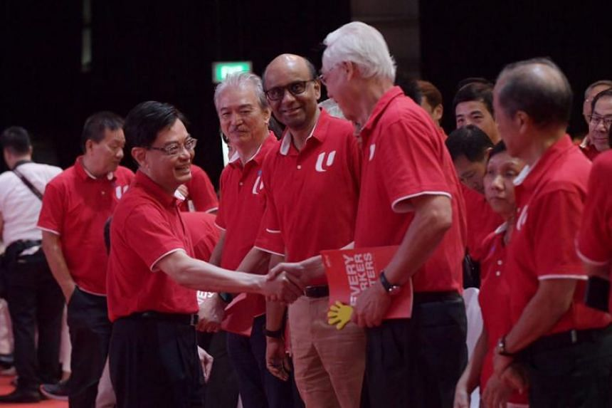 Deputy Prime Minister Heng Swee Keat (left) shaking hands with Emeritus Senior Minister Goh Chok Tong at the May Day Rally 2019 in Downtown East on May 1, 2019.
