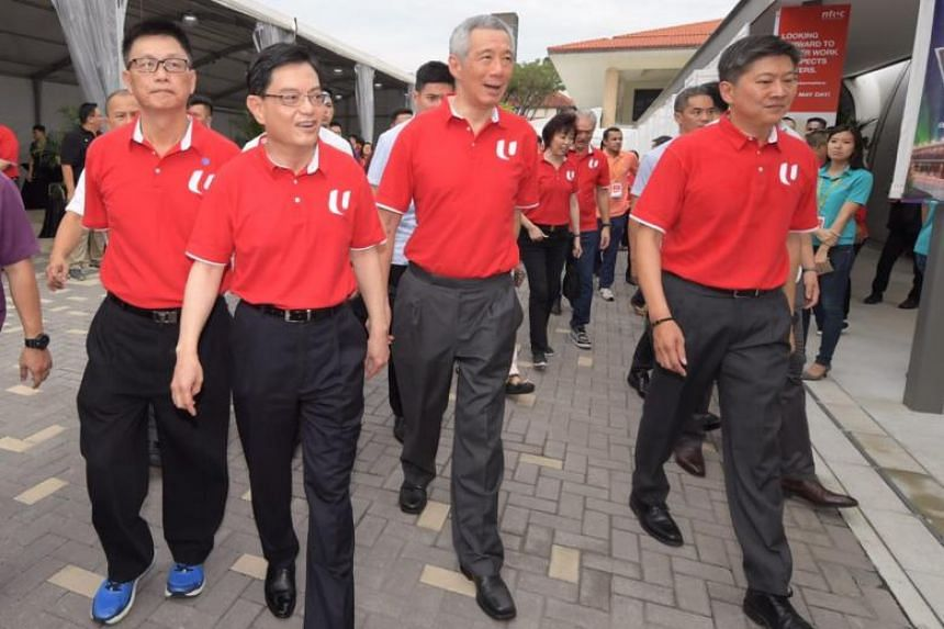 (From left) NTUC vice-president Tan Hock Soon, Deputy Prime Minister Heng Swee Keat, Prime Minister Lee Hsien Loong and Labour Chief Ng Chee Meng arriving for the NTUC May Day Rally 2019 at Downtown East on May 1, 2019.