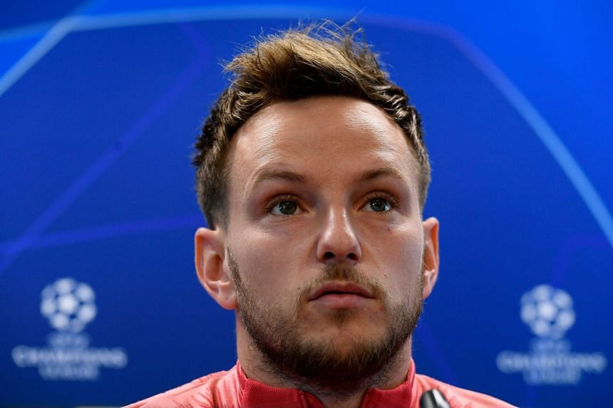 Rakitic holds a press conference in Barcelona.