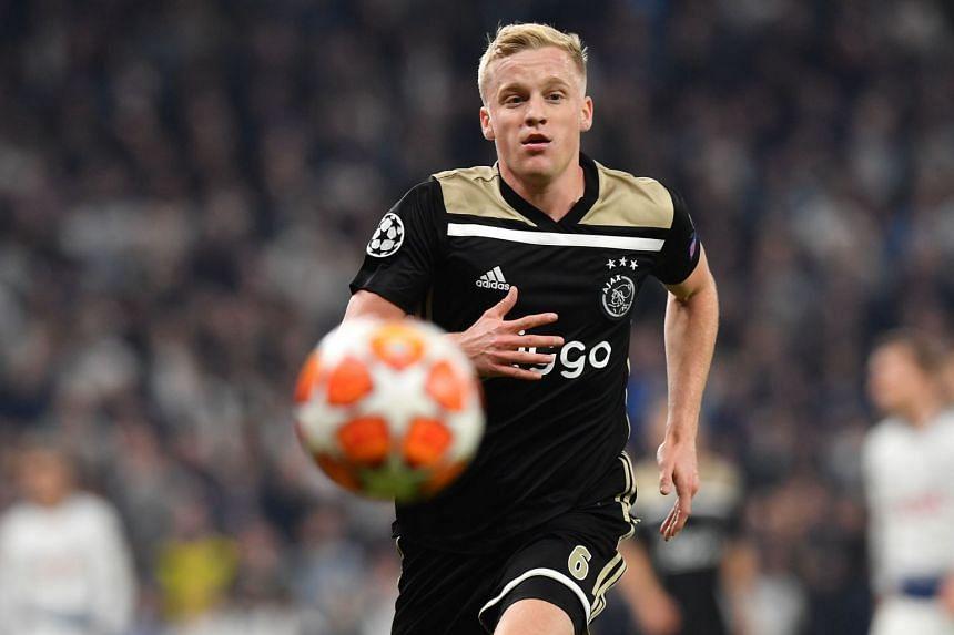 Ajax's Dutch midfielder Donny van de Beek chases the ball.