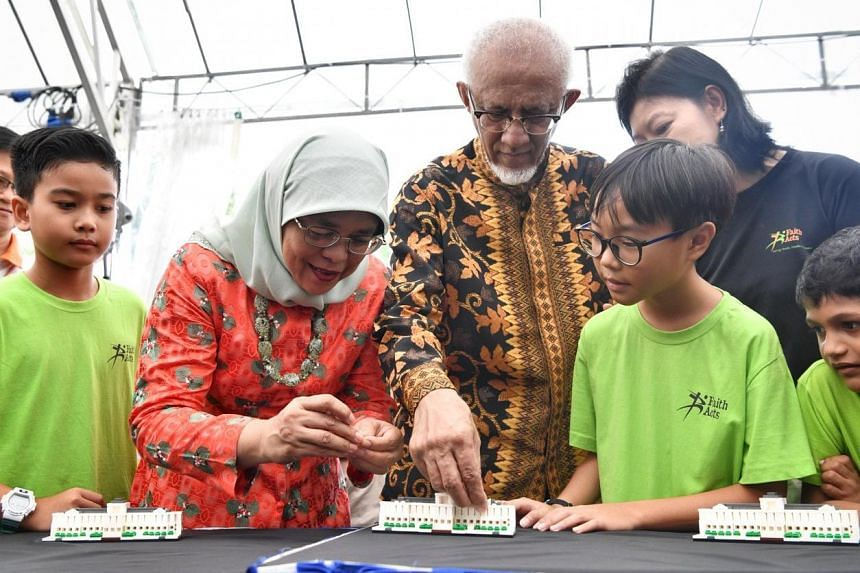 President Halimah Yacob and her husband, Mr Mohamed Abdullah Alhabshee, launch an exclusive Istana model using Lego bricks to commemorate the 150th anniversary of the Istana.