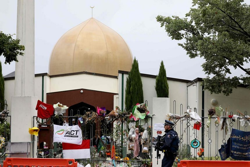 An armed police officer stands guard outside the Al Noor mosque, one of the mosques where some 50 people were killed by a self-avowed white supremacist gunman on March 15, in Christchurch on April 5, 2019.