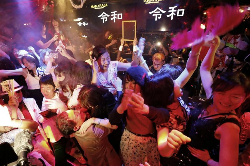 People celebrate the start of Japan's new Reiwa imperial era at the Maharaja nightclub in Tokyo's Roppongi district, on May 1, 2019.