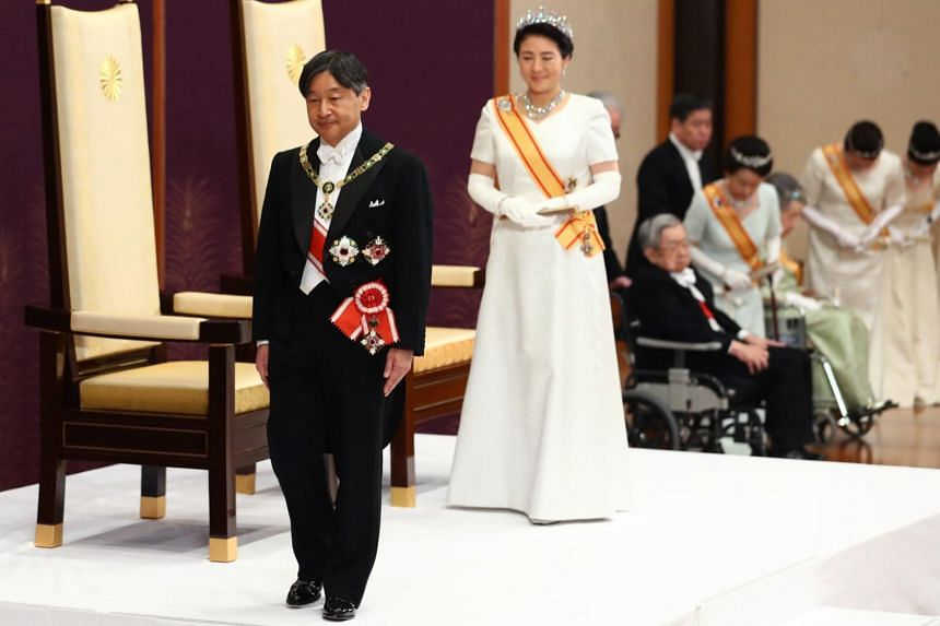 Japan's new Emperor Naruhito and Empress Masako leave at the end of a ceremony, to receive the first audience after the accession to the throne, at the Matsu-no-Ma state room inside the Imperial Palace in Tokyo on May 1, 2019.