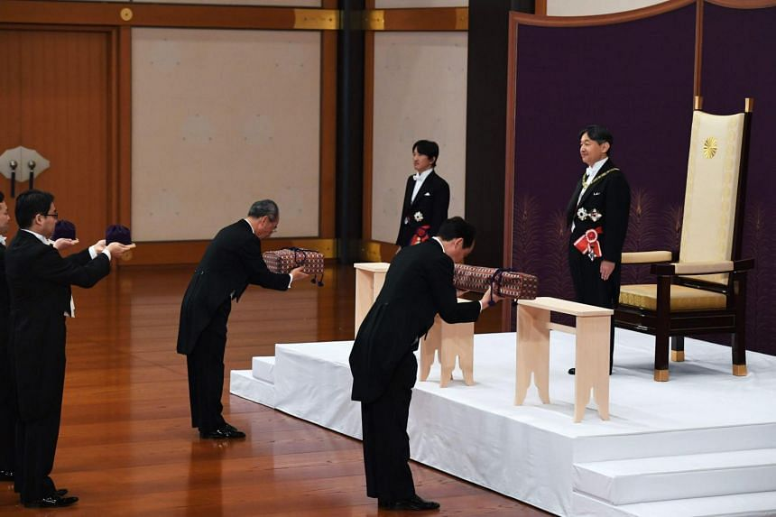 Japan's new Emperor Naruhito (right) attends a ceremony to inherit the imperial regalia and seals at the Matsu-no-Ma state room inside the Imperial Palace in Tokyo on May 1, 2019.