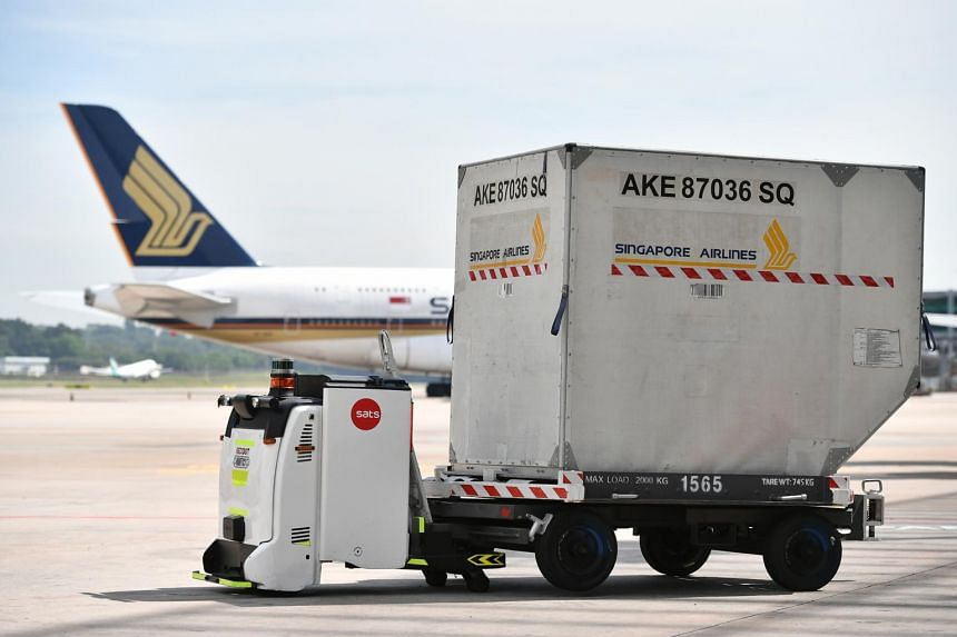 A SATS Technology Autonomous Guided Vehicle with the container trailer at Changi Airport, on May 14, 2018.