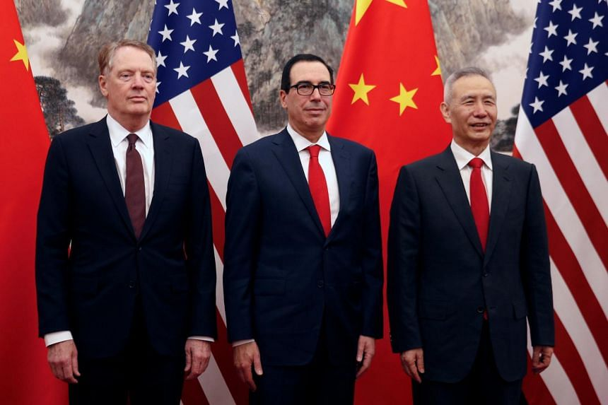 Chinese Vice Premier Liu He (right) poses with US Treasury Secretary Steven Mnuchin (center) and US Trade Representative Robert Lighthizer (left) before their their meeting at the Diaoyutai State Guesthouse in Beijing, on May 1, 2019.