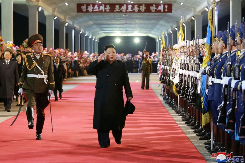 Kim Jong Un (centre) receives a guard of honour at a railway station in North Hamgyong Province after his visit to Russia.