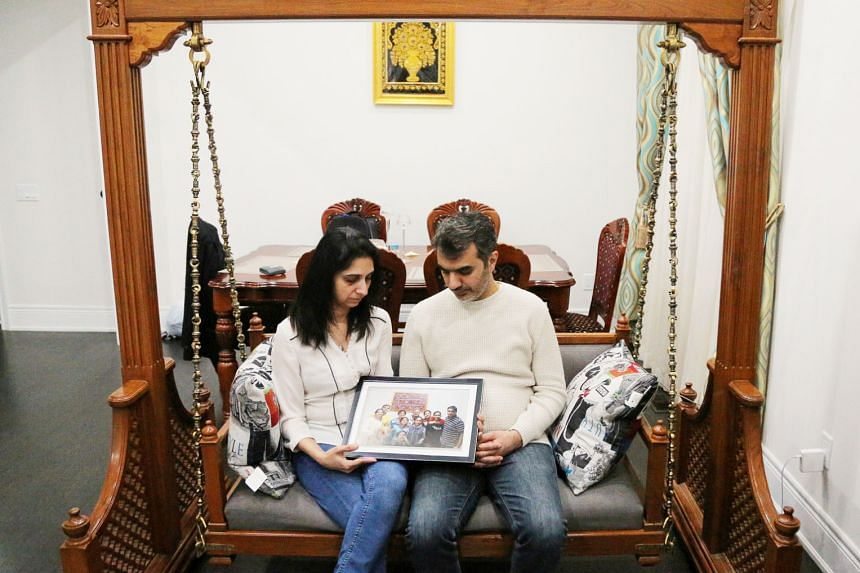 Mr Manant Vaidya and his wife Hiral from Toronto, Canada, with a photograph showing six members of their family who were among the 157 people who died in the Ethiopian Airlines crash on March 10.