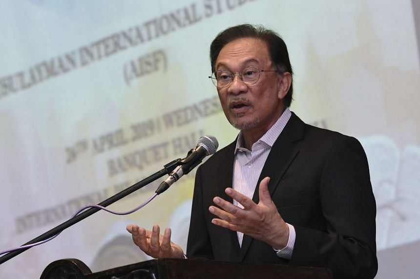 PKR president Anwar Ibrahim (above) said that Prime Minister Mahathir Mohamad's position is very clear, and he is bound by the Constitution.